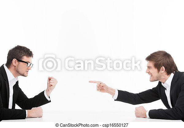 Men?s confrontation. Two angry young business people shouting and blaming each other while isolated on white - csp16550127