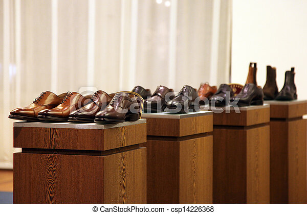Mens shoes in a store display - csp14226368