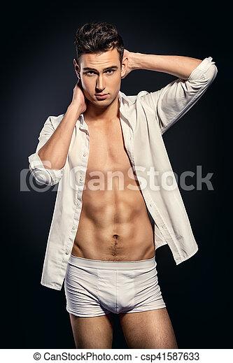 15acdc3236 Mens underwear. Sexy young man in underwear and white shirt. studio ...