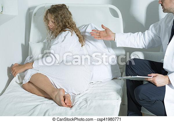 Mental hospital patient and psychiatrist - csp41980771