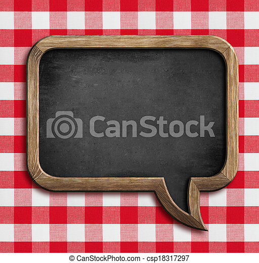 menu chalkboard speech bubble on table with picnic tablecloth - csp18317297