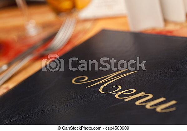 Menu & Cutlery on A Restaurant Table - csp4500909