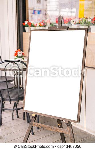 Menu frame in front of Restaurant . - csp43487050