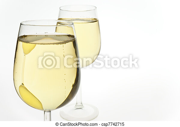 Merry Christmas and happy New year. Pair of champagne flutes making a toast, isolated on white background. - csp7742715