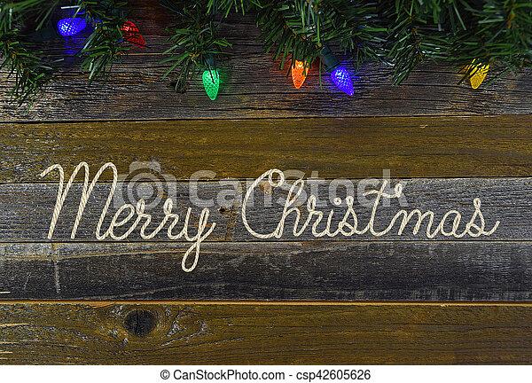 Merry Christmas rope on rustic wood - csp42605626