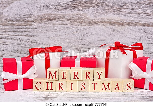 merry christmas wooden blocks with red and white gift boxes csp51777796 - Merry Christmas Decorative Blocks