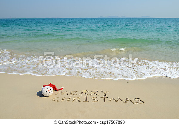 merry christmas written on tropical beach white sand with xmas snowman csp17507890 - Merry Christmas Beach Images