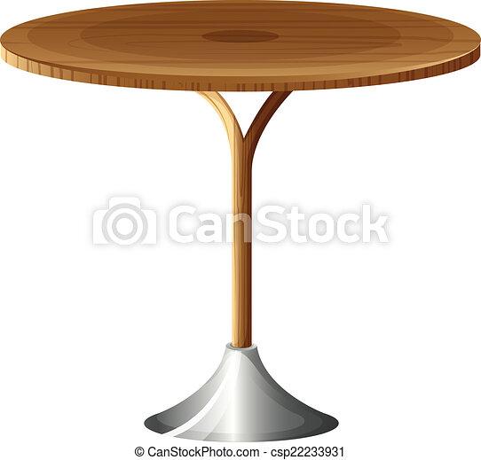 Una mesa redonda de madera - csp22233931