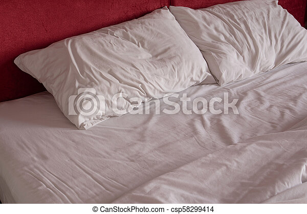 Messy Bed Sheets And Pillow   Csp58299414