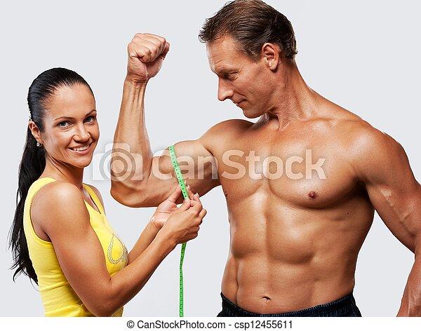 mesurer, femme, athletic's, biceps., homme - csp12455611