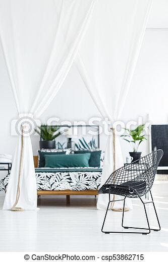 Metal black chair in bedroom - csp53862715