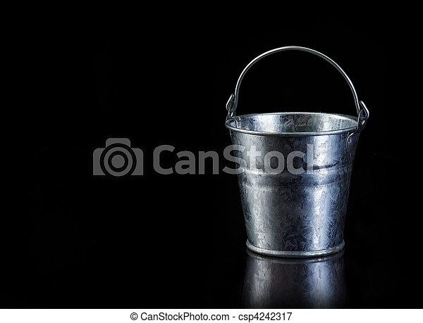 Metal bucket on black with copy spa - csp4242317