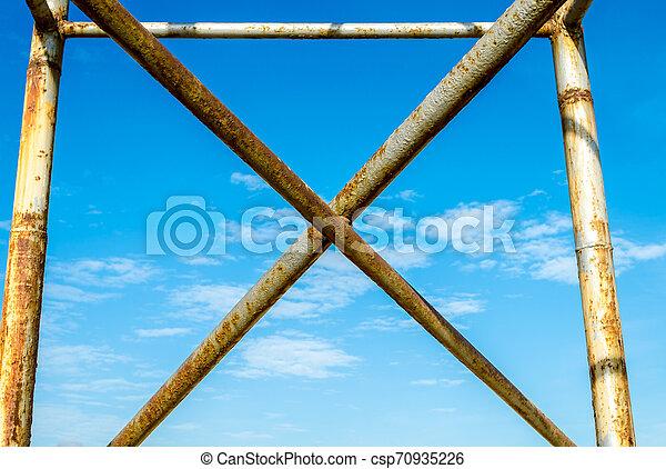metal cross against the blue sky - csp70935226