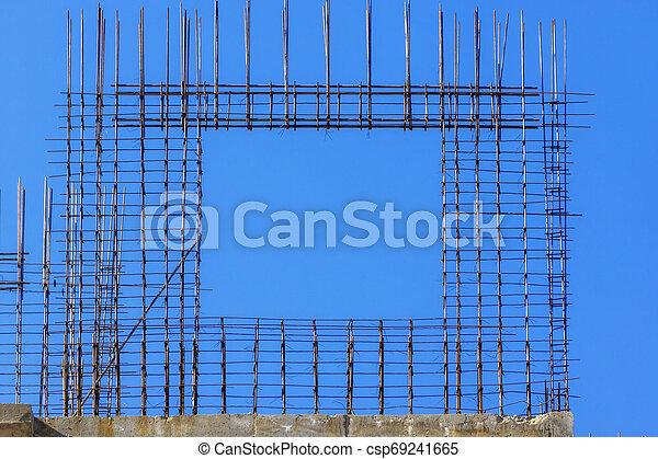 Metal frame window at building construction - csp69241665