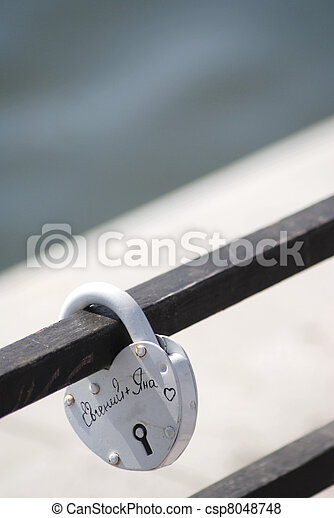 metal lock of love on an iron structure - csp8048748