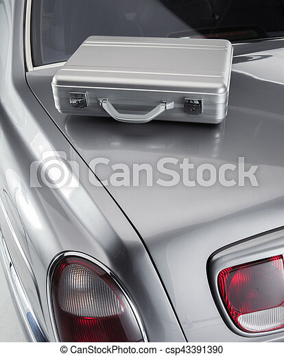 Metal luxery briefcase from a business man on the car boot - csp43391390