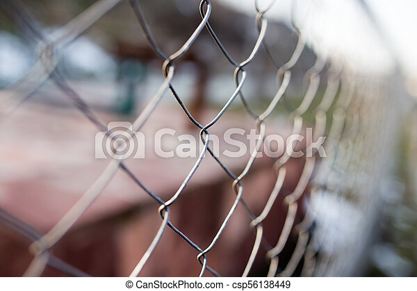 Metal mesh on the fence as a background - csp56138449