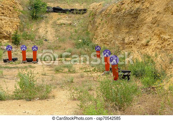Metal orange targets at the shooting range. Pepper popper target - csp70542585