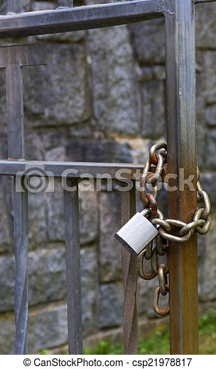 Metal padlock and chain - csp21978817