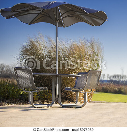 Metal Picnic Table And Umbrella With Scenic Background - Metal picnic table with umbrella