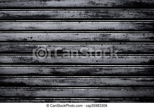 metal roller shutter door - csp35983306 & Metal roller shutter door dark texture background.