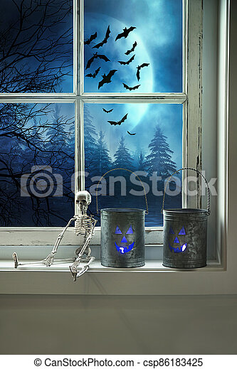 Metal tins with candles on window sill - csp86183425