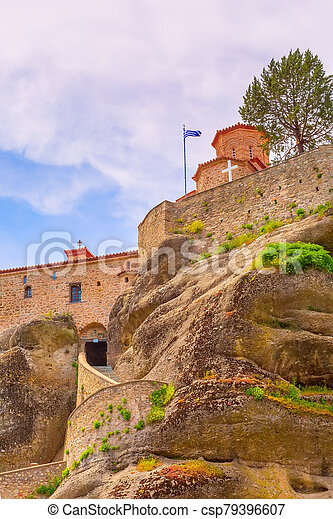 Meteora monastery on the high cliff, Greece - csp79396607