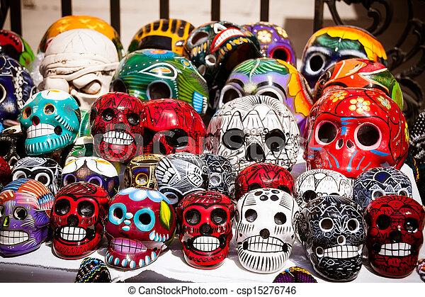 an assortment of colorful mexican sugar skulls at a street fair
