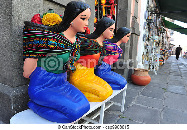 Mexican woman statues - csp9908615