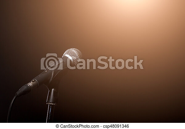 Microphone in light of spotlight - csp48091346