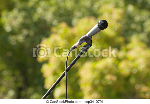 microphone on green background - csp3410791