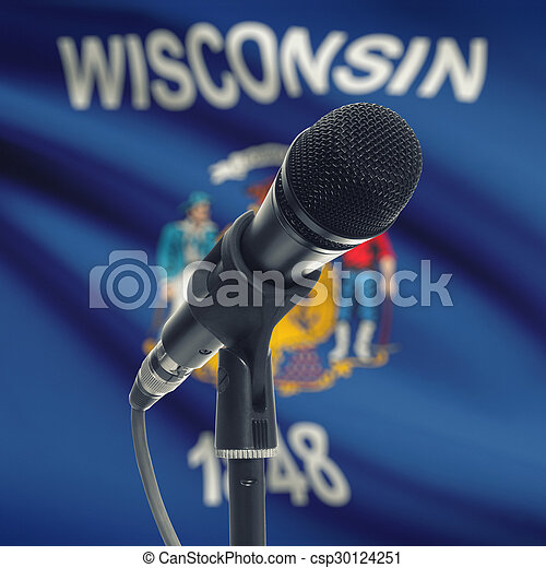 Microphone on stand with US state flag on background - Wisconsin - csp30124251