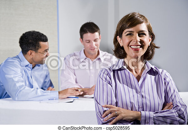 Mid-adult female office worker, in meeting - csp5028595