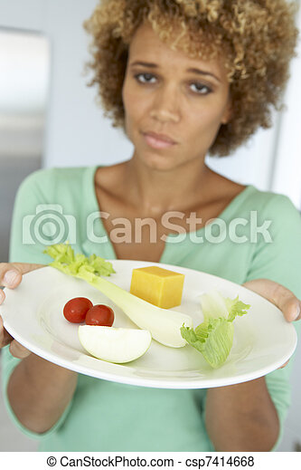 Mid Adult Woman Holding A Plate Of Healthy Food - csp7414668