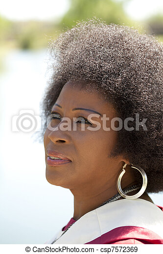 Middle Aged African American Woman outdoor portrait - csp7572369