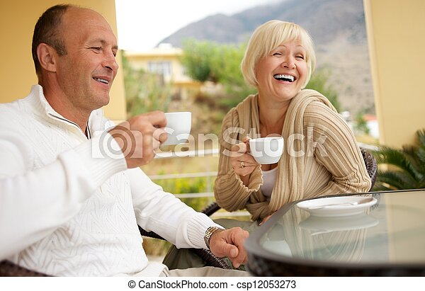 Middle-aged couple drinking caffee - csp12053273