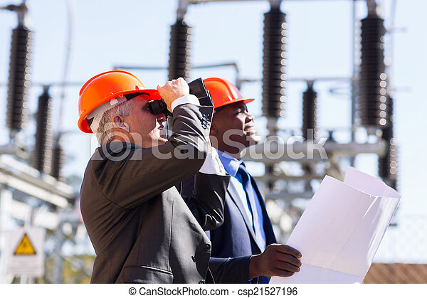 middle aged engineer with binoculars  - csp21527196