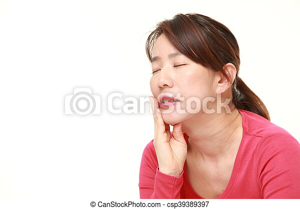middle aged Japanese woman suffers from toothache - csp39389397
