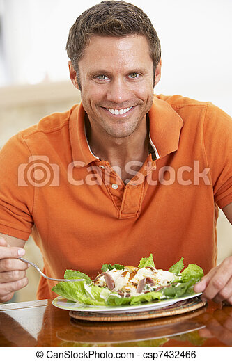 Middle Aged Man Eating A Healthy Meal - csp7432466