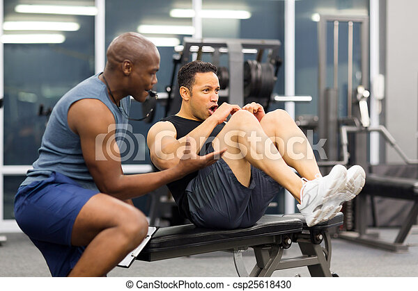 middle aged man with personal trainer - csp25618430