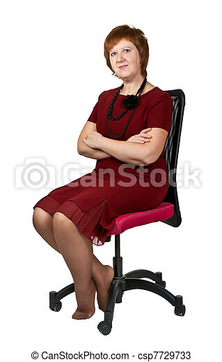 middle-aged woman in a chair - csp7729733