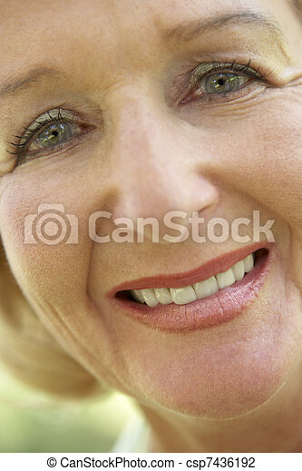 Middle Aged Woman Smiling At The Camera - csp7436192