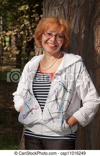 Middle-aged woman smiling - csp11016249