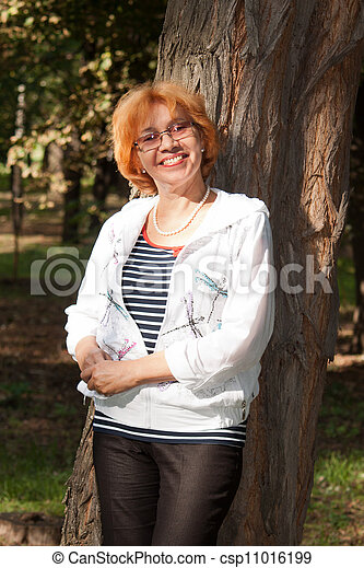 Middle-aged woman smiling - csp11016199