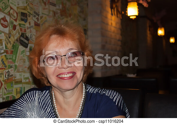 Middle-aged woman smiling - csp11016204