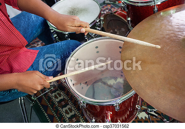 Midsection Of Female Drummer Performing - csp37031562