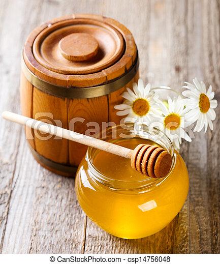 Jar de miel con flores de margarita - csp14756048