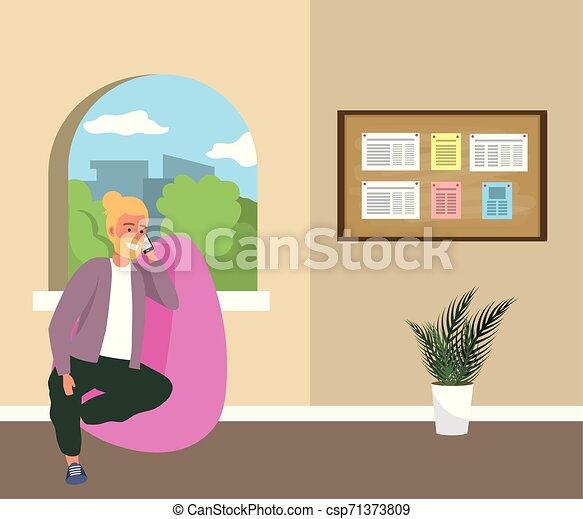 Estudiante de Millennial sentado en la sala de espera - csp71373809