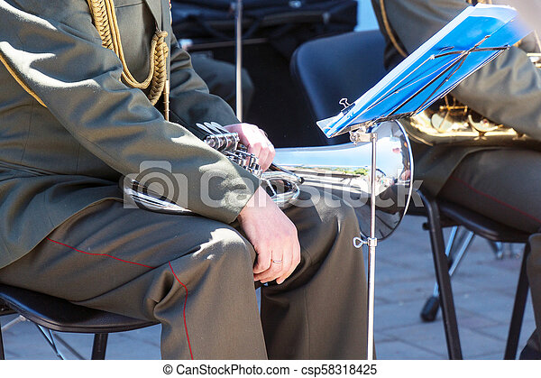 Military band musician with a wind instrument baritone - csp58318425