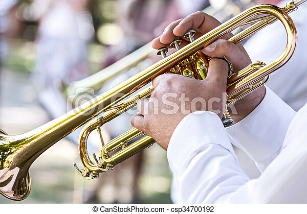 military brass band musician with trumpet - csp34700192